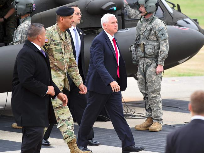US Vice President Mike Pence (C) arrives at army base Camp Bonifas in Paju near the truce village of Panmunjom during a visit to the Demilitarized Zone (DMZ) on the border between North and South Korea on April 17, 2017. Picture: Jung Yeon-Je