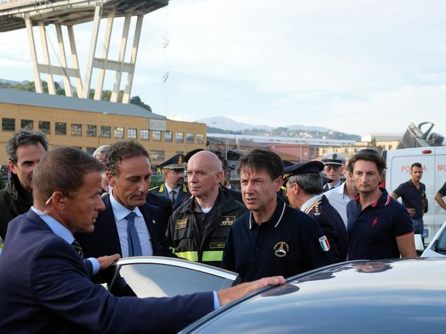 Italian Prime Minister Giuseppe Conte, centre, has announced a 12-month state of emergency in Genoa. Picture: AFP.