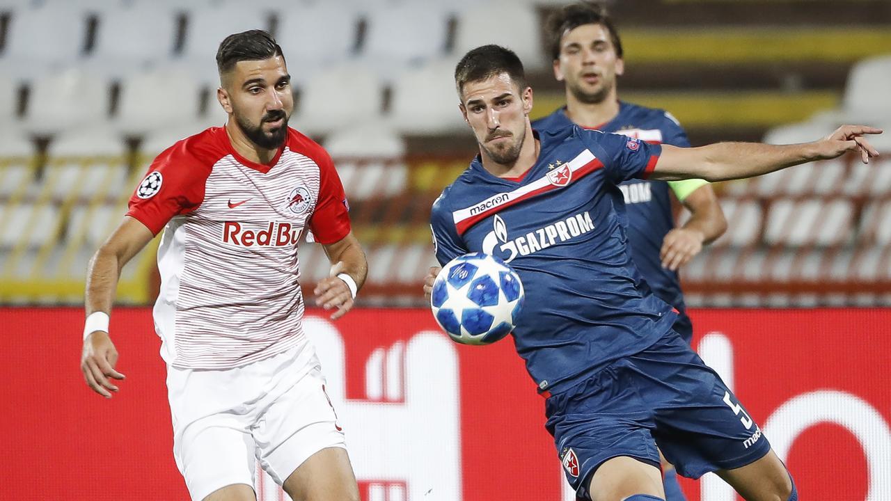 Milos Degenek (R) in action for Red Star.