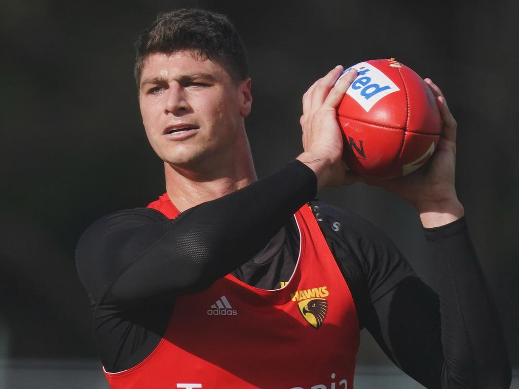 Jonathon Patton of the Hawks marks the ball during an AFL Hawthorn Football Club training session at The Ricoh Centre in Mulgrave, Wednesday, June 3, 2020. (AAP Image/Michael Dodge) NO ARCHIVING