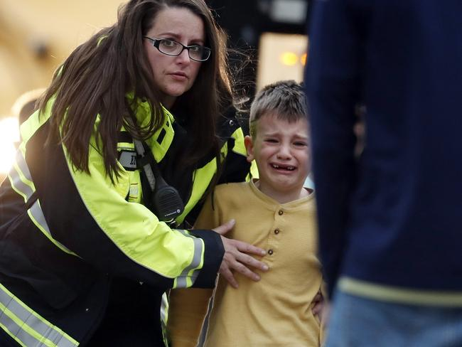Children were seen crying after being evacuated from the school. Picture: David Zalubowski/AP
