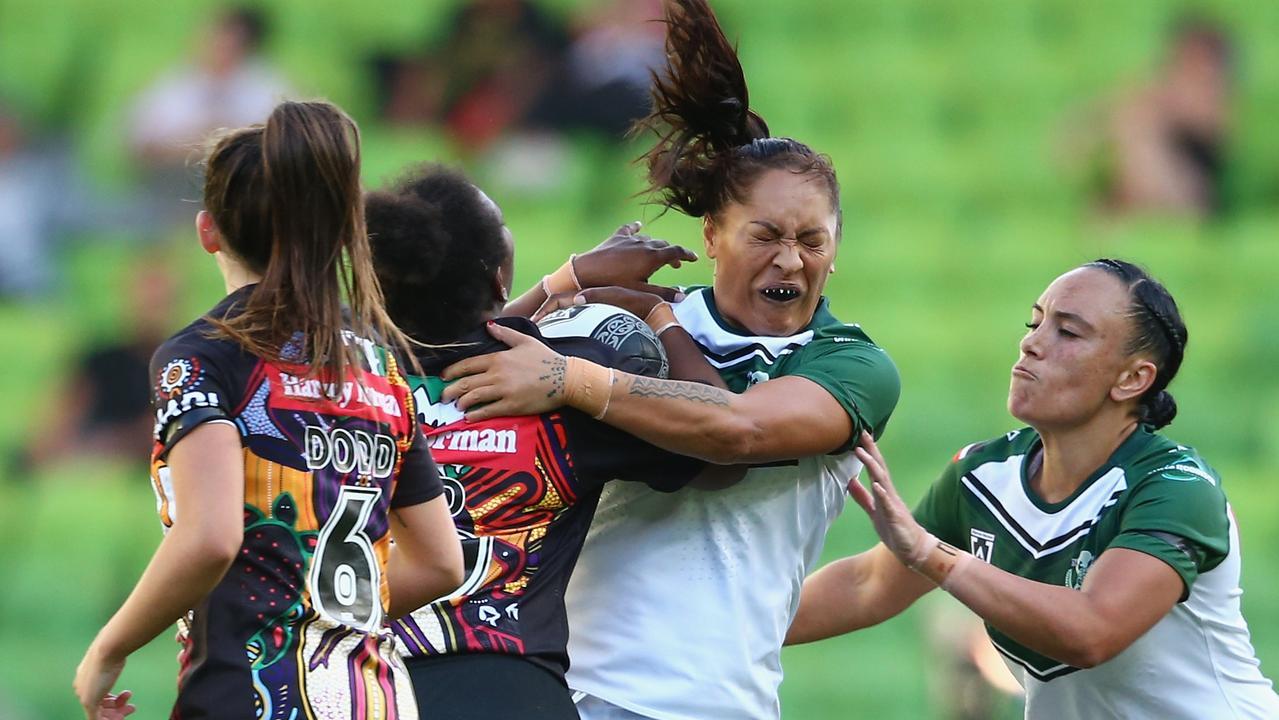 Kathleen Wharton of New Zealand Maori Ferns is tackled.