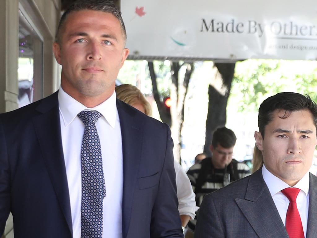 Sam Burgess arrives at Moss Vale court with his legal team which includes Brian Wrench. Picture: John Grainger