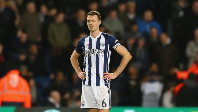 Jonny Evans is the subject of a transfer tug of war between Arsenal and Manchester City