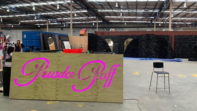 "The workshop also makes decorations for the Mardi Gras party such as the ""powder puff"" sign above. Picture: Benedict Brook"