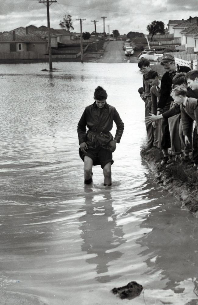In 1955, schoolboys brave floodwaters in Jordanville. Picture: Frank Grant/ARGUS COLLECTION