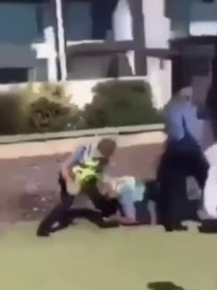 Police restrain one youth. Picture: Nine News
