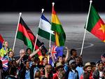 Athletes and flagbearers arrive for the closing ceremony of the 2018 Gold Coast Commonwealth Games at the Carrara Stadium. (AFP PHOTO/Anthony WALLACE)