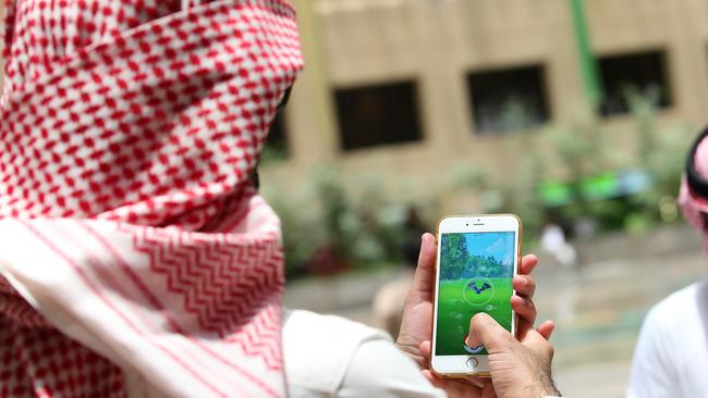 Saudi men play with the Pokemon Go application on their mobiles in the capital Riyadh. Picture: AFP