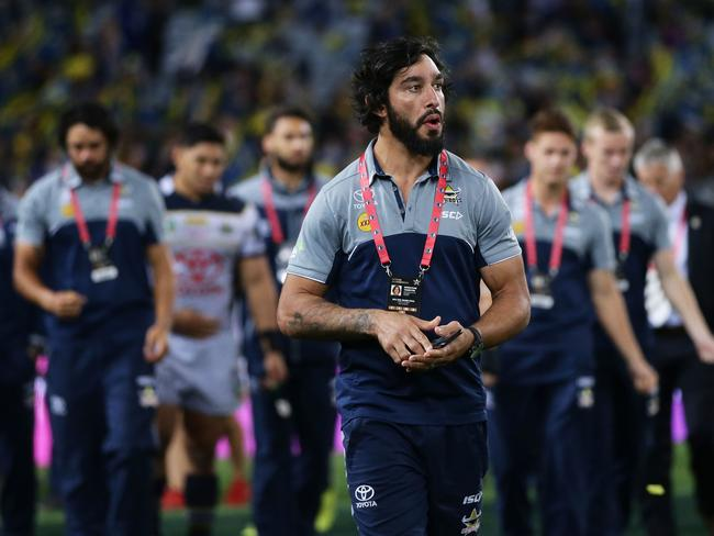 Injured player Johnathan Thurston of the Cowboys looks on.