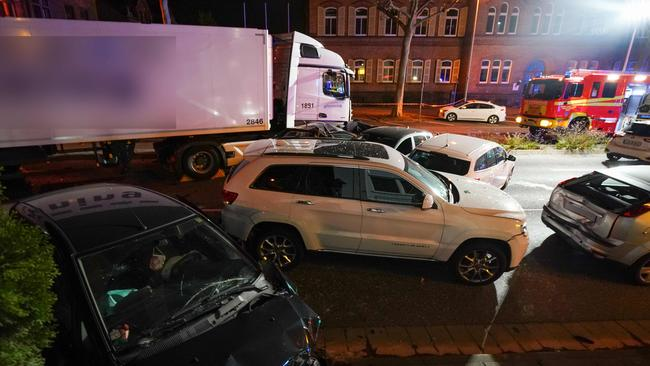 The truck crashed into cars stopped at a red light in Limburg, western Germany. Picture: dpa/AFP