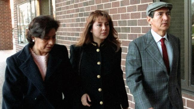 Lorena Bobbitt (centre) accompanied by her mother Elvia and father Carlos. Picture: AP Photo/Willima Philpott