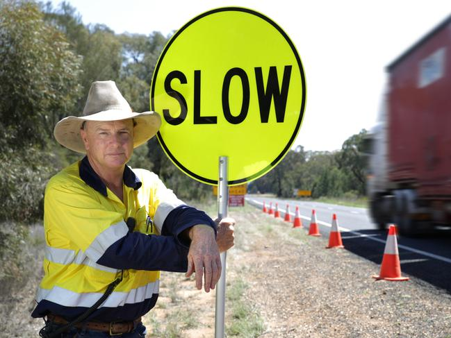 RMS works assistant Evan Kew is pleading with motorists to slow down and think about road workers on the sides of highways. Picture: Dean Marzolla