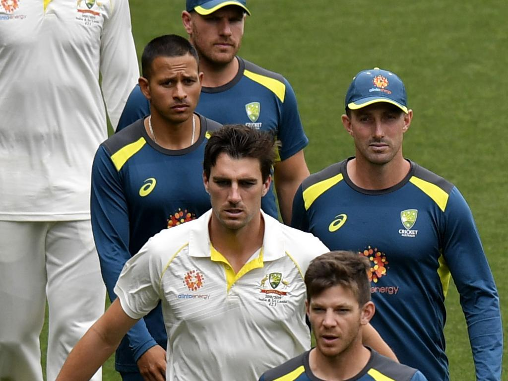 Captain Tim Paine of Australia leads his team to congratulate India on the win during day five of the first Test match between Australia and India at the Adelaide Oval in Adelaide, Monday, December 10, 2018. (AAP Image/Kelly Barnes) NO ARCHIVING, EDITORIAL USE ONLY, IMAGES TO BE USED FOR NEWS REPORTING PURPOSES ONLY, NO COMMERCIAL USE WHATSOEVER, NO USE IN BOOKS WITHOUT PRIOR WRITTEN CONSENT FROM AAP