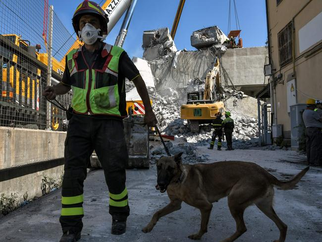 Rescuers inspect the rubble and wreckages at the Morandi motorway bridge. Picture: AFP