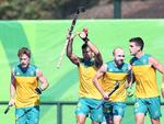 Australia's Chris Ciriello (second from left) celebrates scoring a goal during the men's field hockey Australia vs New Zealand match.