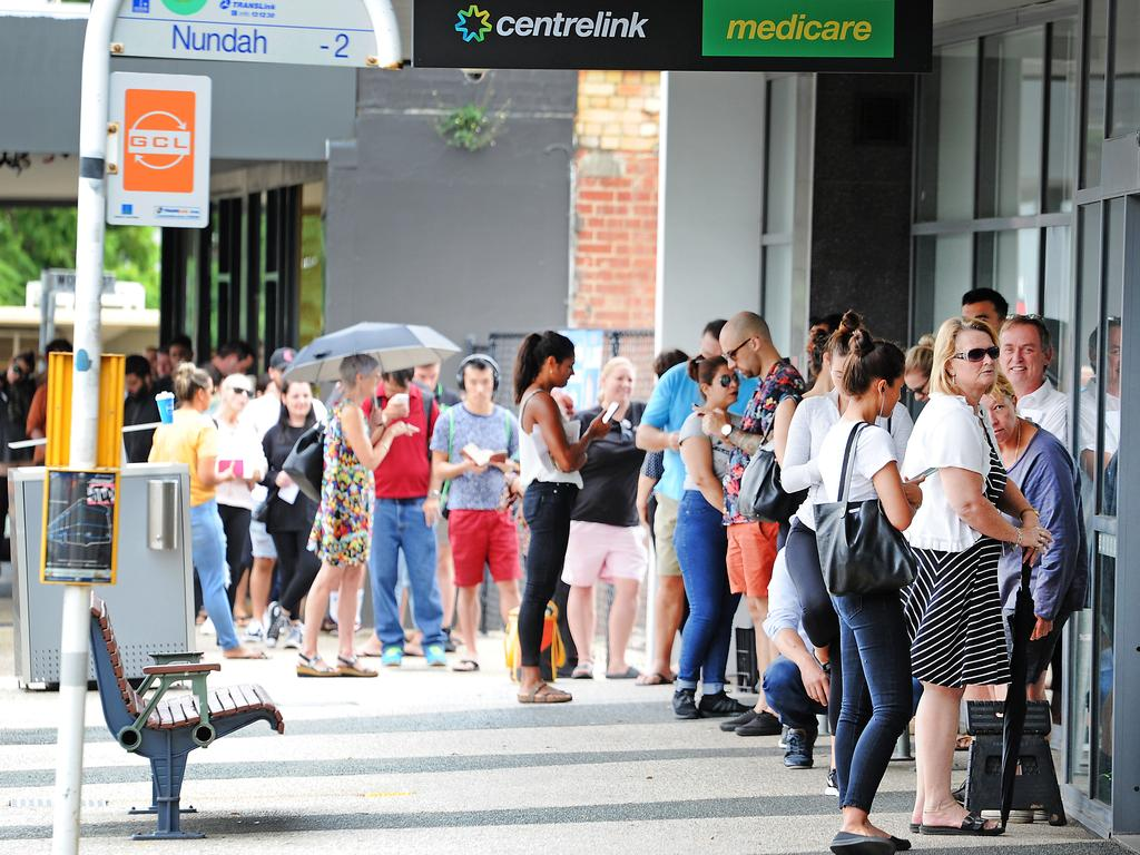 People lining up for hours to register at Centrelink Nundah, Queensland. Picture: AAP
