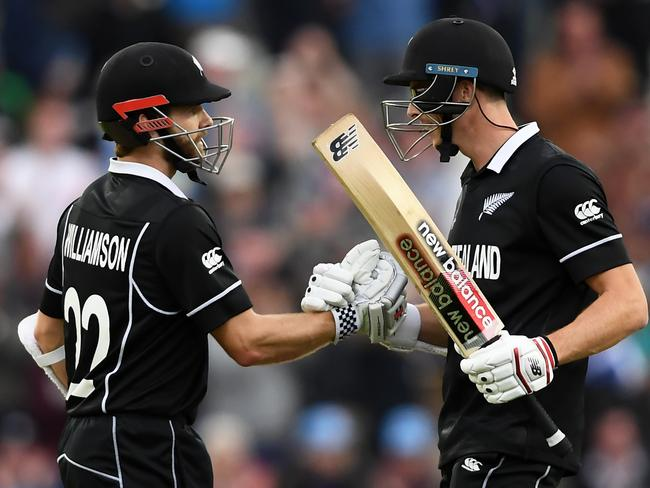 Kane Williamson and Mitchell Santner celebrate their four-wicket victory.