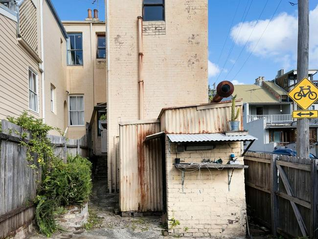 Run down with peeling walls and rust stains, this Balmain house passed in at auction and is up for sale at $1.7m. Picture: realestate.com.au
