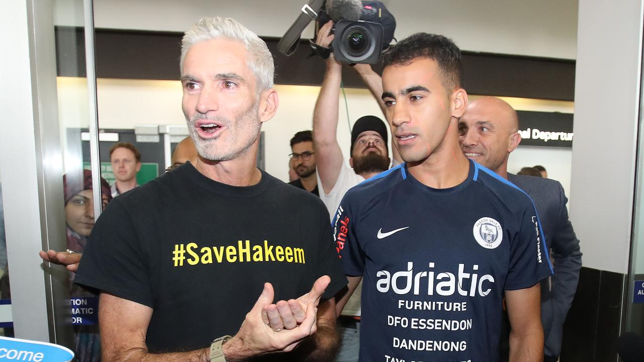Hakeem al-Araibi walks with Craig Foster. (Photo by Scott Barbour/Getty Images)