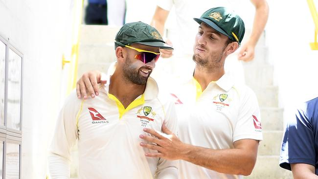Nathan Lyon (left) and Mitchell Marsh walk out for play on Day 2 of the third Test.