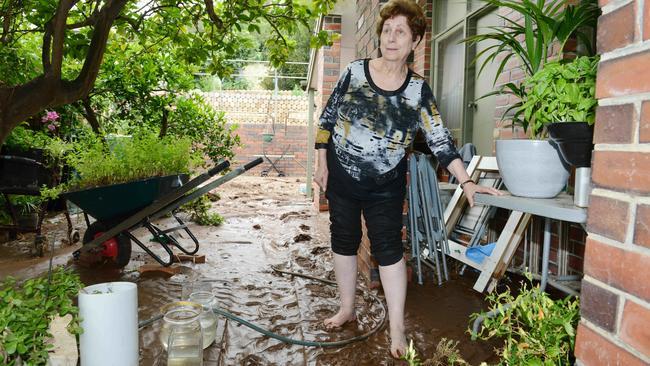 Maria Donato, 80, surveys the flooding to her property. AAP Image/ Brenton Edwards