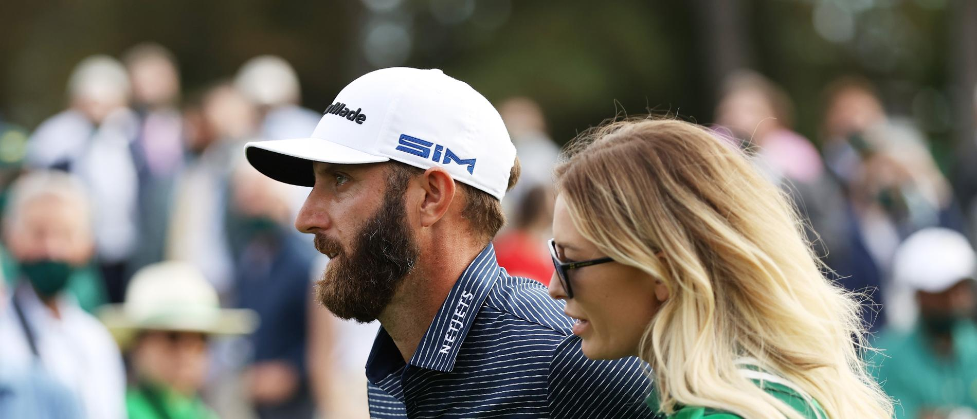 AUGUSTA, GEORGIA - NOVEMBER 15: Dustin Johnson of the United States walks with fiancée Paulina Gretzky after winning the Masters at Augusta National Golf Club on November 15, 2020 in Augusta, Georgia. (Photo by Patrick Smith/Getty Images)