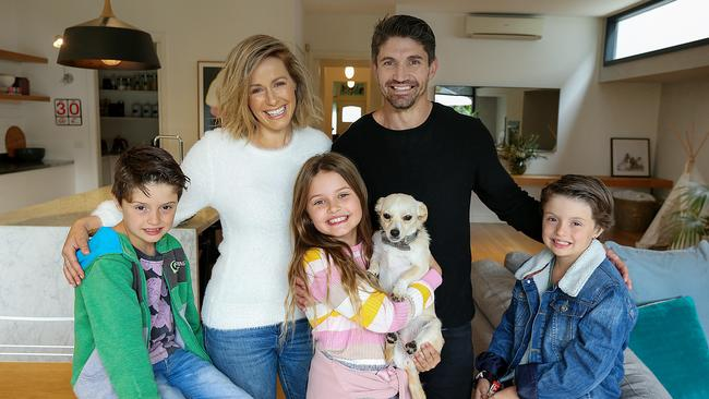 Former Collingwood footballer Brodie Holland with wife Sarita, children Bowie, 8, Stevie, 8, Kip, 8, and their dog Freddy at their Ascot Vale home. Picture: Ian Currie