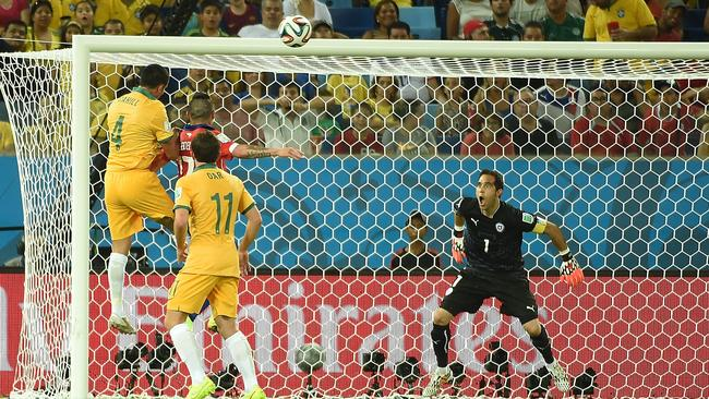Tim Cahill scores with his head against Chile.