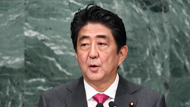 Japan's Prime Minister Shinzo Abe is seeking to introduce a legal ceiling on the amount of overtime work a person can do per month.