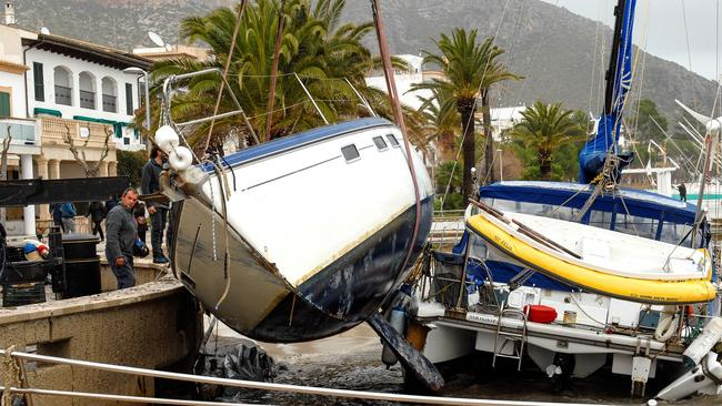 Boats are stacked awkwardly against the bank in the aftermath of the storm at the Pollenca port in Majorca. Picture: EPA/ATIENZA