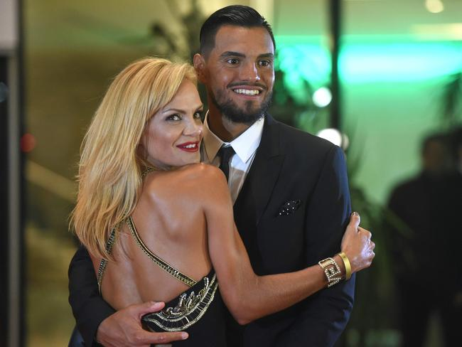 Sergio Romero with his wife Eliana Guercio