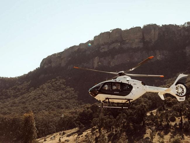 A helicopter arrives in to the Wolgan Valley resort.