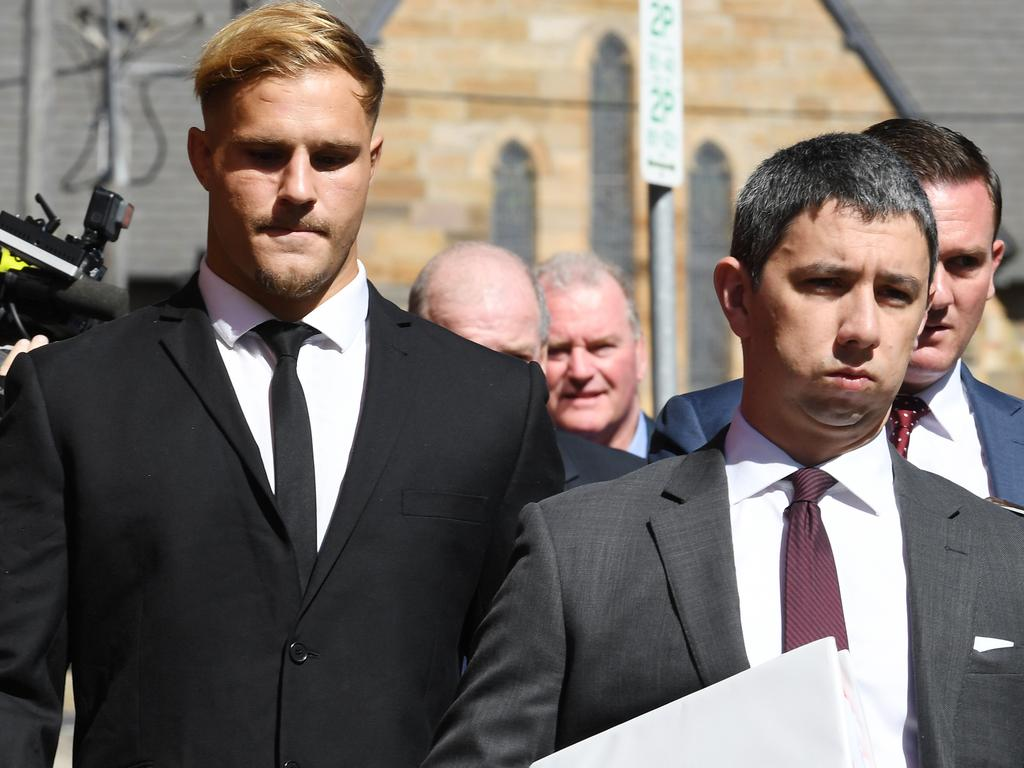 St. George Illawarra Dragons player Jack de Belin (left) leaves Wollongong Local Court in Wollongong, Tuesday, February 12, 2019. (AAP Image/Dean Lewins) NO ARCHIVING