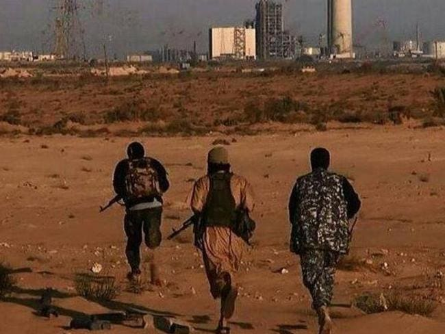 Battleground ... Islamic State fighters approach a power plant in the Libyan city of Sirte. Picture: Supplied.