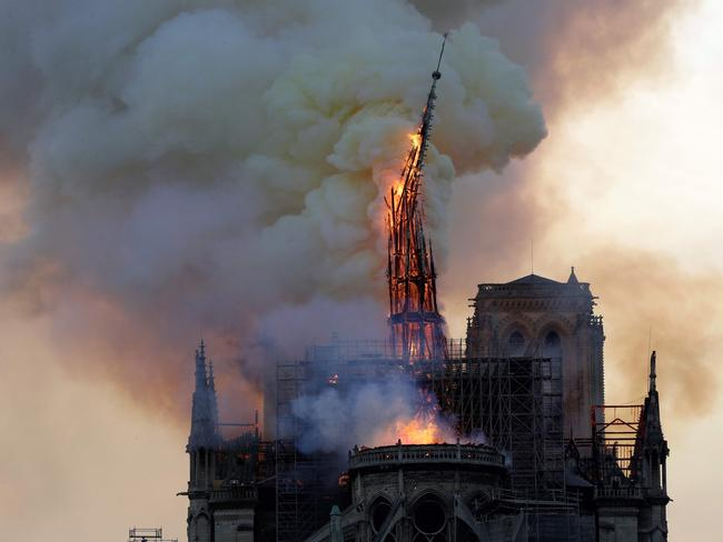 The iconic spire collapses. Picture: AFP