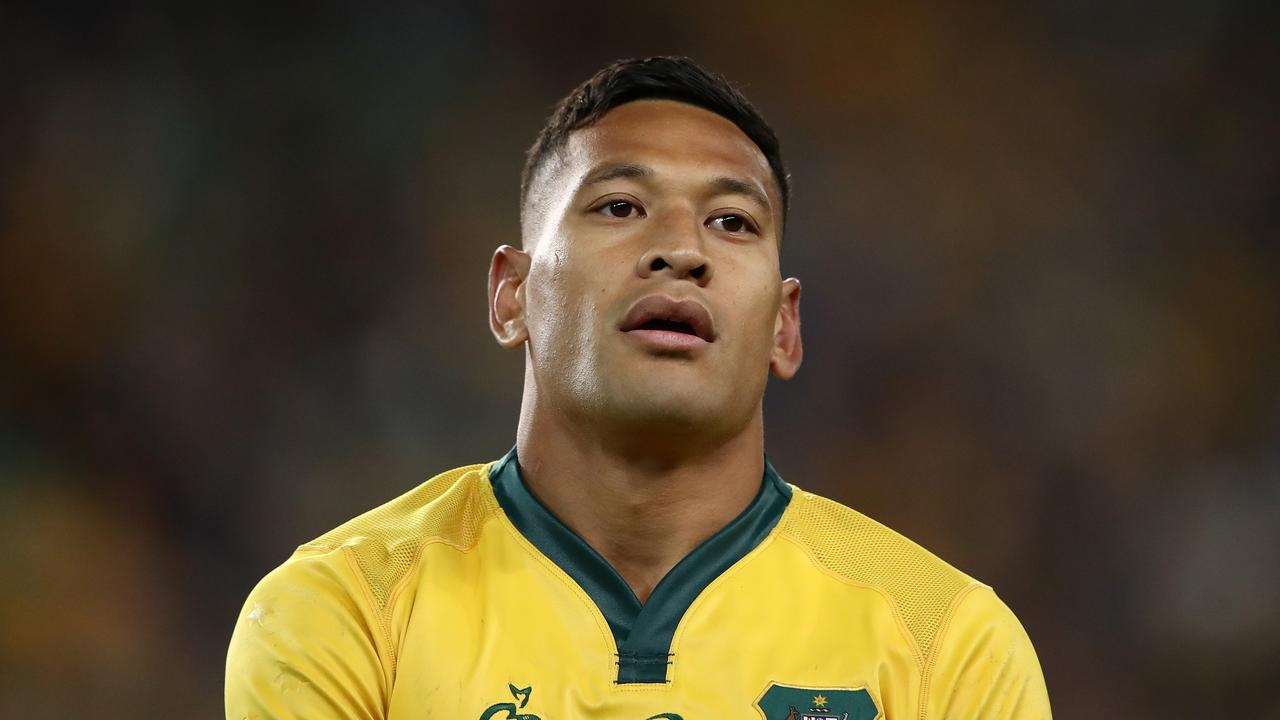Folau playing with the Wallabies last year