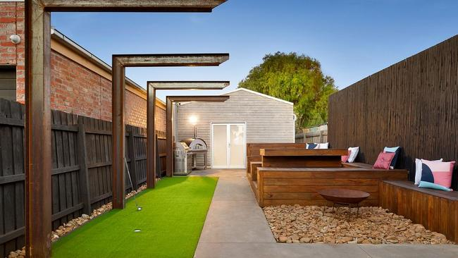 The home's large block features a putting green and man cave.