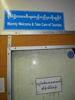 The new welcome sign amid the grime. Picture: Ryan Wright/Turnipseed Travel
