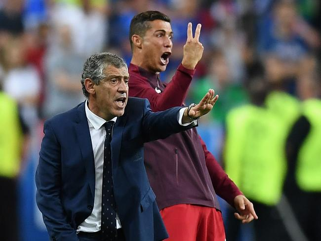 Ronaldo yells instructions alongside actual Portugal manager Fernando Santos.