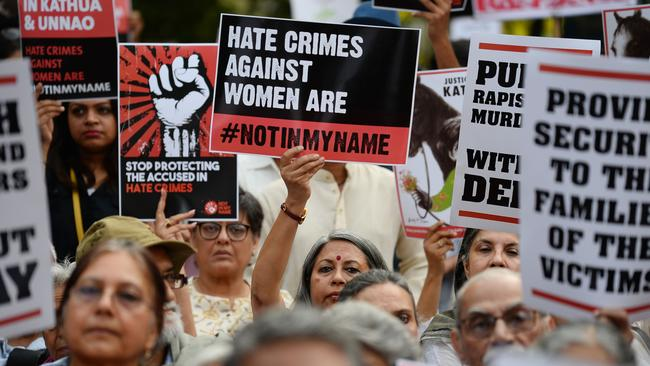 Indian demonstrators hold placards during a 'Not In My Name' protest on April 15, 2018 in support of rape victims following high profile cases in Jammu and Kashmir and Uttar Pradesh states, in New Delhi. Picture: AFP/Sajjad Hussain