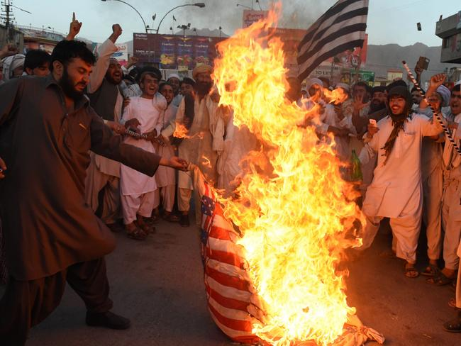 Pakistani Sunni Muslim supporters of hard line pro-Taliban party Jamiat Ulema-i-Islam-Nazaryati (JUI-N) torch a US flag during a protest in Quetta, against a US drone strike in Pakistan's southwestern province Balochistan in which killed Afghan Taliban leader Mullah Akhtar Mansour. Picture: AFP