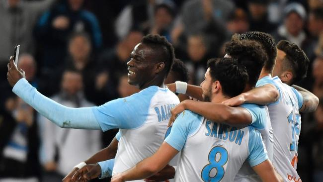 b6e8d23e64975 Marseille's Italian forward Mario Balotelli (L) takes a selfie with  teammates after scoring during the French L1 football match between Olympique  de ...