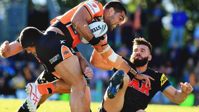 Adam Blair is gang tackled by Josh Mansour and a Panthers teammate.