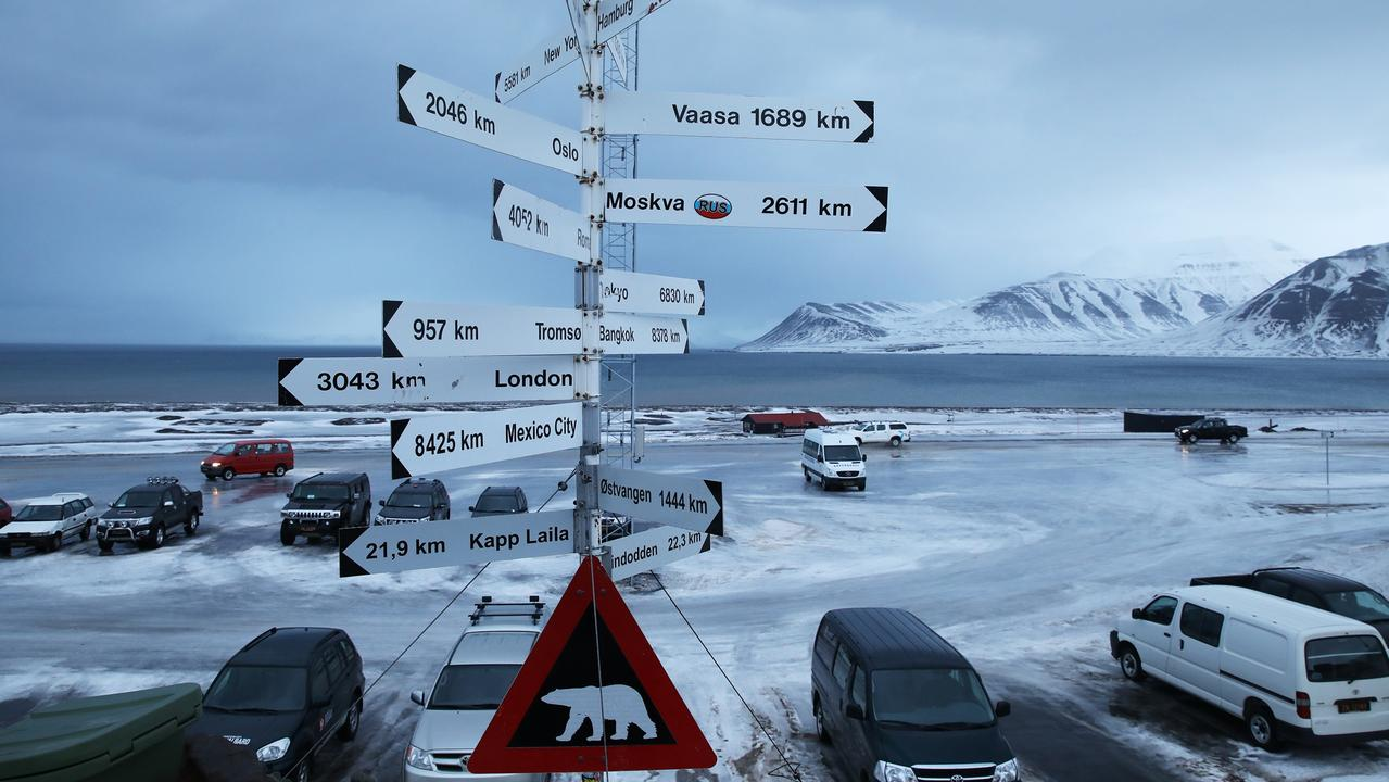Polar bear warning sign and city distances outside Longyearbyen airport. Picture: Ella Pellegrini