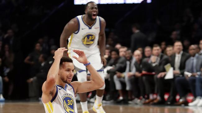 Curry and Green react after a no foul call. Picture: AP