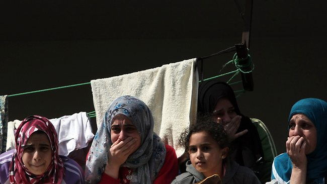 Palestinian women mourn during the funeral of members from the al-Dallu family in Gaza City. Picture: AFP