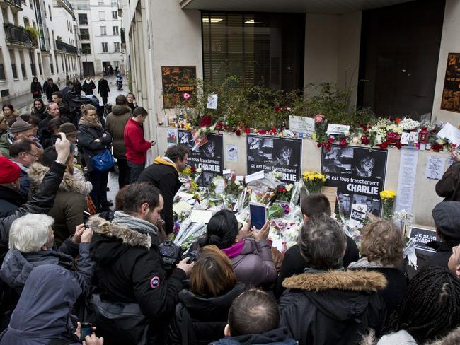 In memory ... The site of the shooting at the office of satirical magazine Charlie Hebdo in Paris, France in which 12 people died on January 8. Picture: Ella Pellegrini