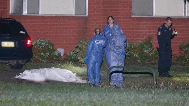 A white sheet covers the body of the man shot dead in a Kingswood driveway. Picture: Bill Hearne
