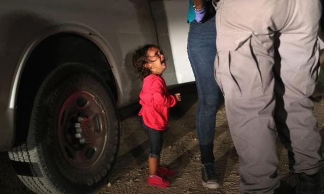 "MCALLEN, TX - JUNE 12: A two-year-old Honduran asylum seeker cries as her mother is searched and detained near the U.S.-Mexico border on June 12, 2018 in McAllen, Texas. The asylum seekers had rafted across the Rio Grande from Mexico and were detained by U.S. Border Patrol agents before being sent to a processing center for possible separation. Customs and Border Protection (CBP) is executing the Trump administration's ""zero tolerance"" policy towards undocumented immigrants. U.S. Attorney General Jeff Sessions also said that domestic and gang violence in immigrants' country of origin would no longer qualify them for political asylum status. John Moore/Getty Images/AFP == FOR NEWSPAPERS, INTERNET, TELCOS & TELEVISION USE ONLY =="